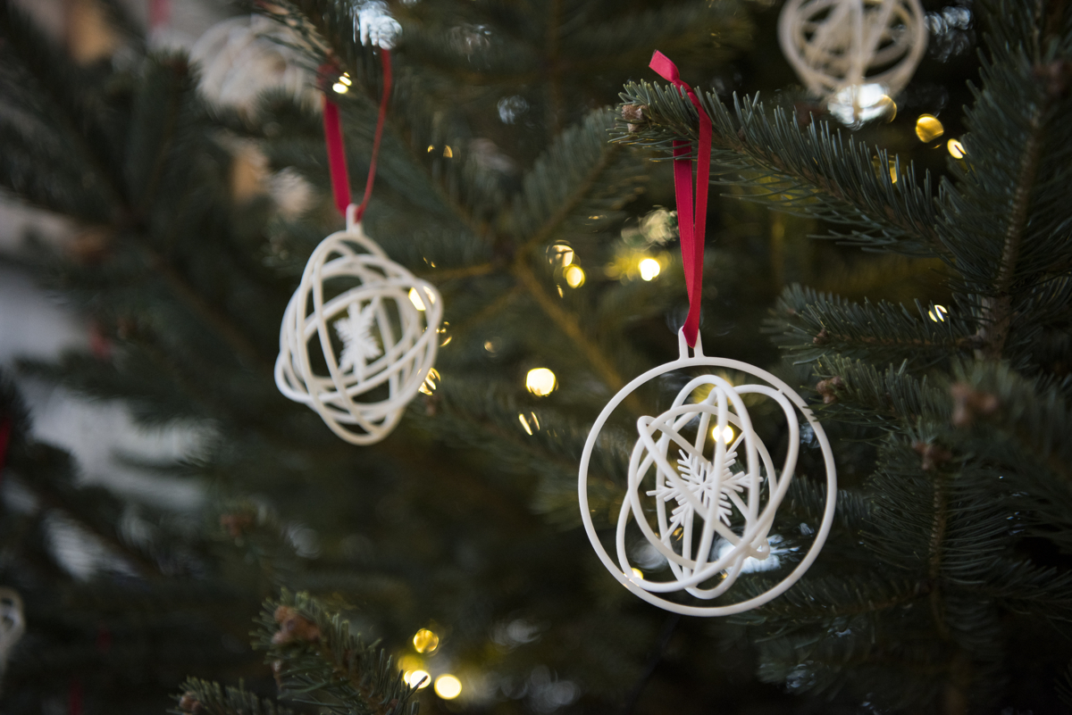 White Christmas ornaments with snowflakes and cirkles.