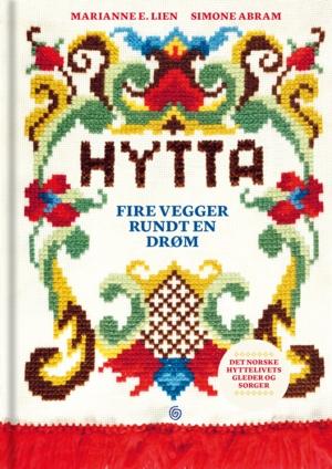Bokforside med teksten Hytta. Fire vegger rundt en drøm.