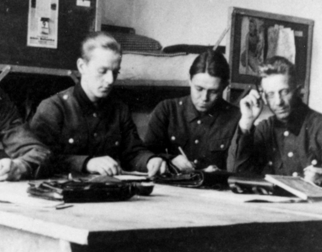 Historic photo of soldiers writing letters.