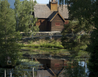 Garmo stave church reflecting in the lake at Maihaugen open air museum.