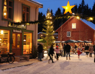 The main street in the old town at the open air museum Maihaugen, with Christmas decorations and a Christmas tree.