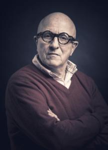 Portrait of Kjell Erik Killi-Olsen with round glasses.