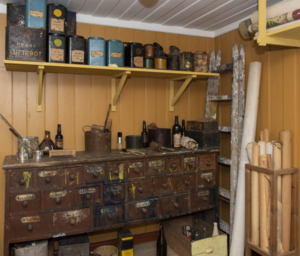 Historic painter workshop with workbench with many drawers and various equipment.