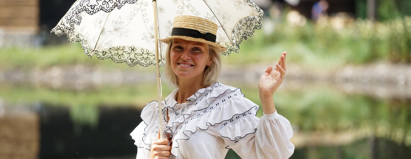 Fine English lady with umbrella.