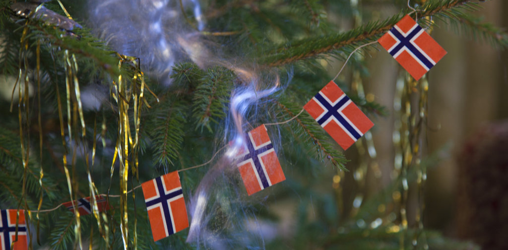Christmas tree decorated with Norwegian flags, candles and more.
