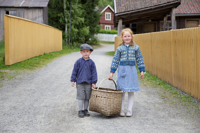 Boy and girl in clothes from the old days at Maihaugen open-air museum in Lillehammer.