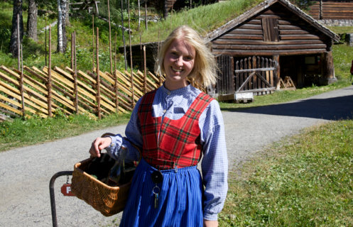 Guide dressed in her national costume at the open-air museum Maihaugen in Lillehammer.