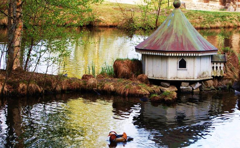Little house for the ducks in the lake at Maihaugen.