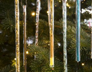 Glass tube Christmas ornaments on a tree.