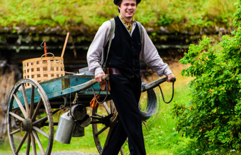 A gipsy man in old looking clothes with a trolley at Maihaugen open-air museum in Lillehammer.